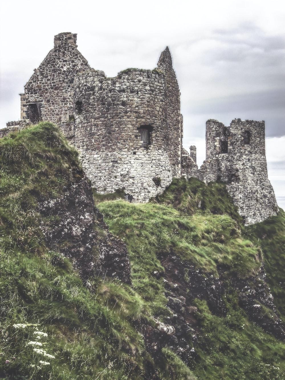 gray ruin house on top on mountain