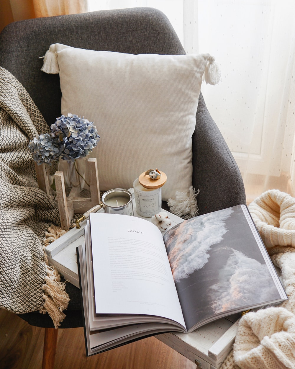 open book beside throw pillow
