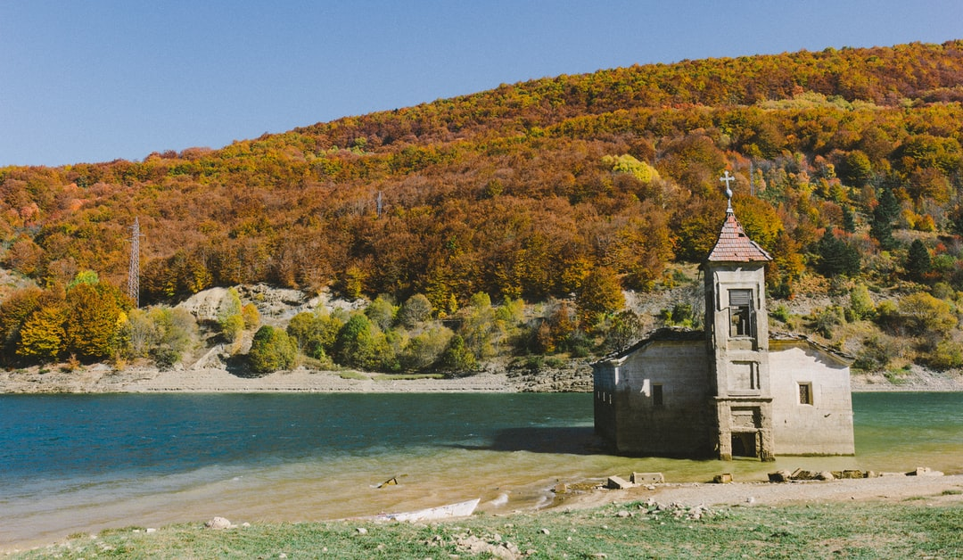 Underwater church in Mavrovo on an autumn scenery