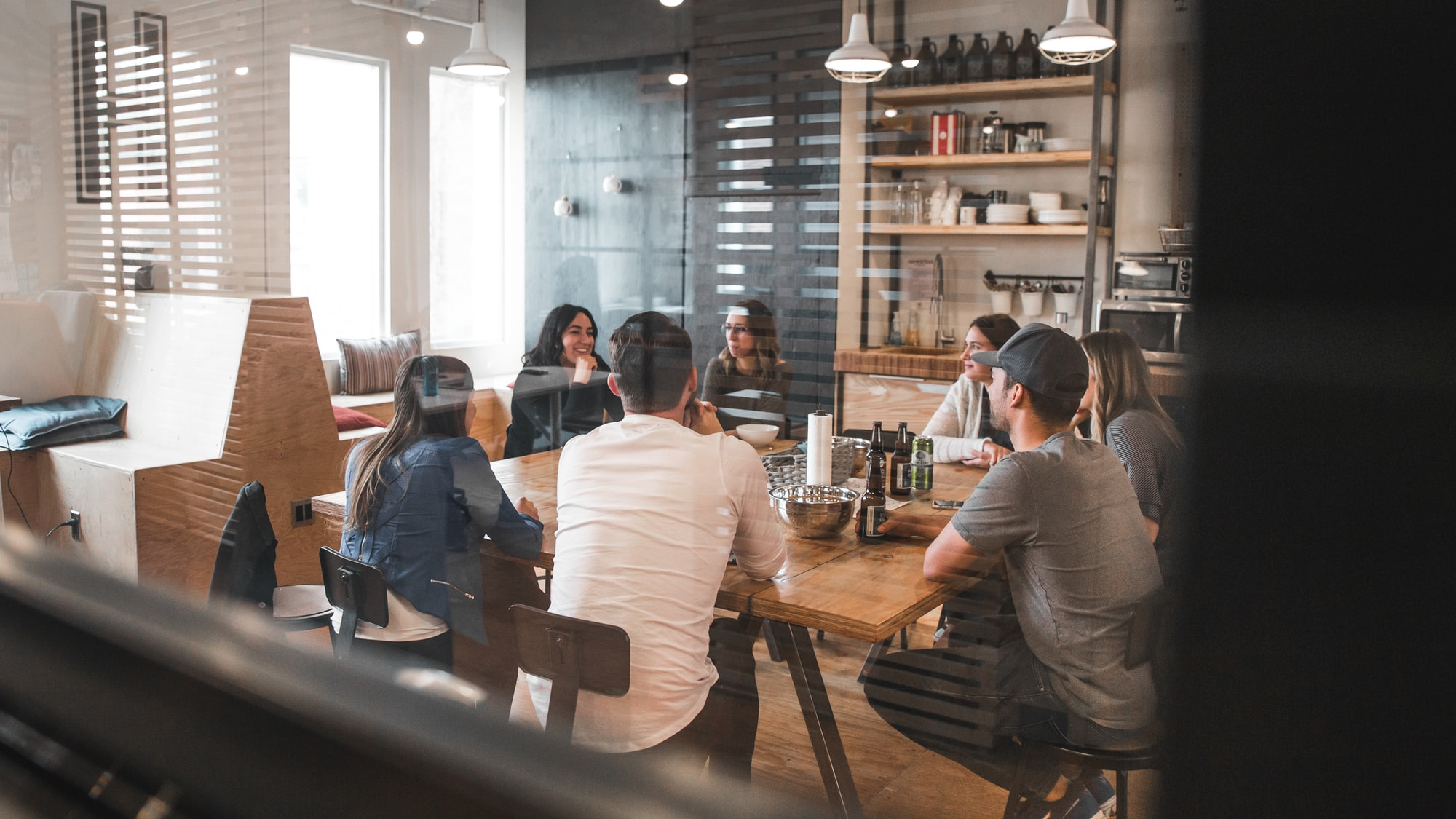 People sitting on chairs around a table in a collaborative meeting