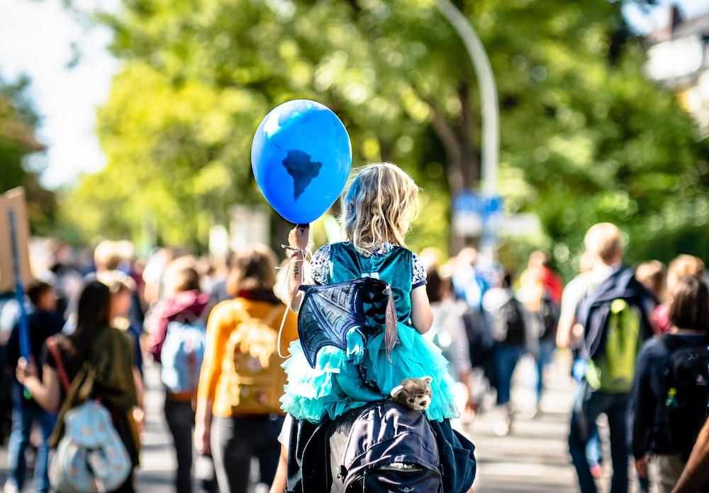 girl holding balloon