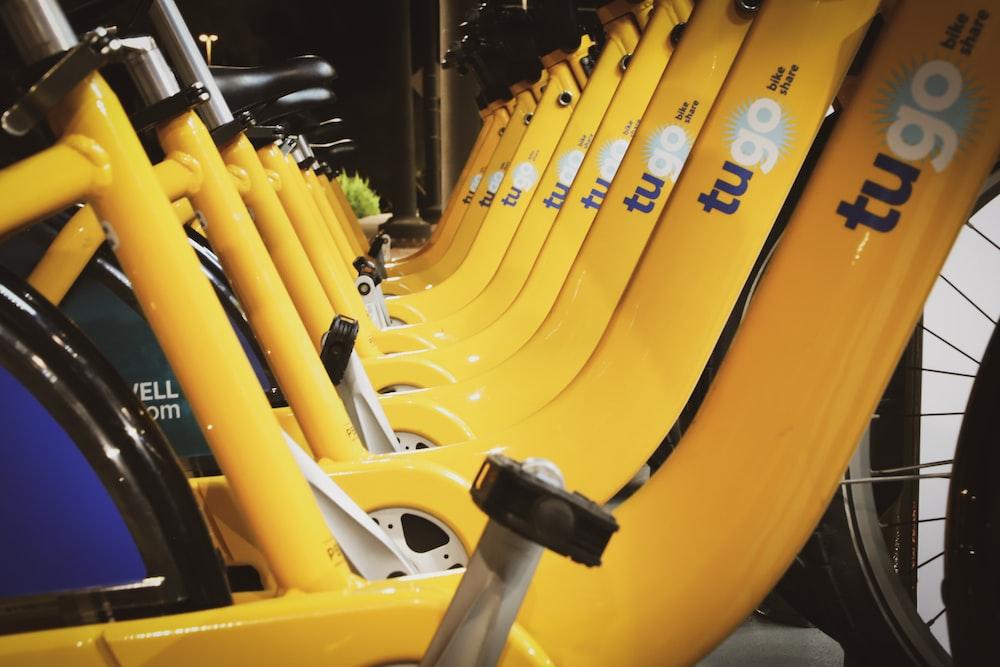 line of parked yellow Tugo bikes