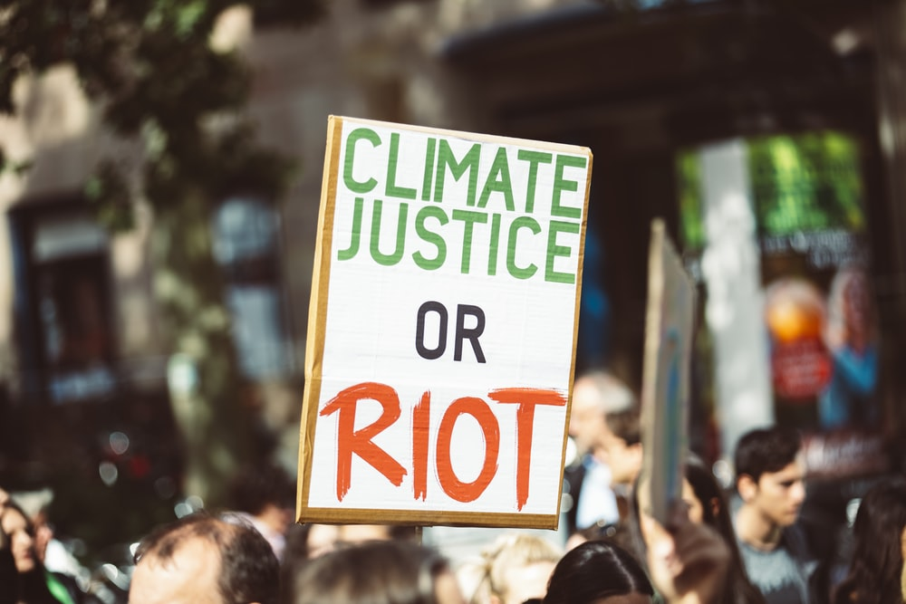 climate justice or riot signage