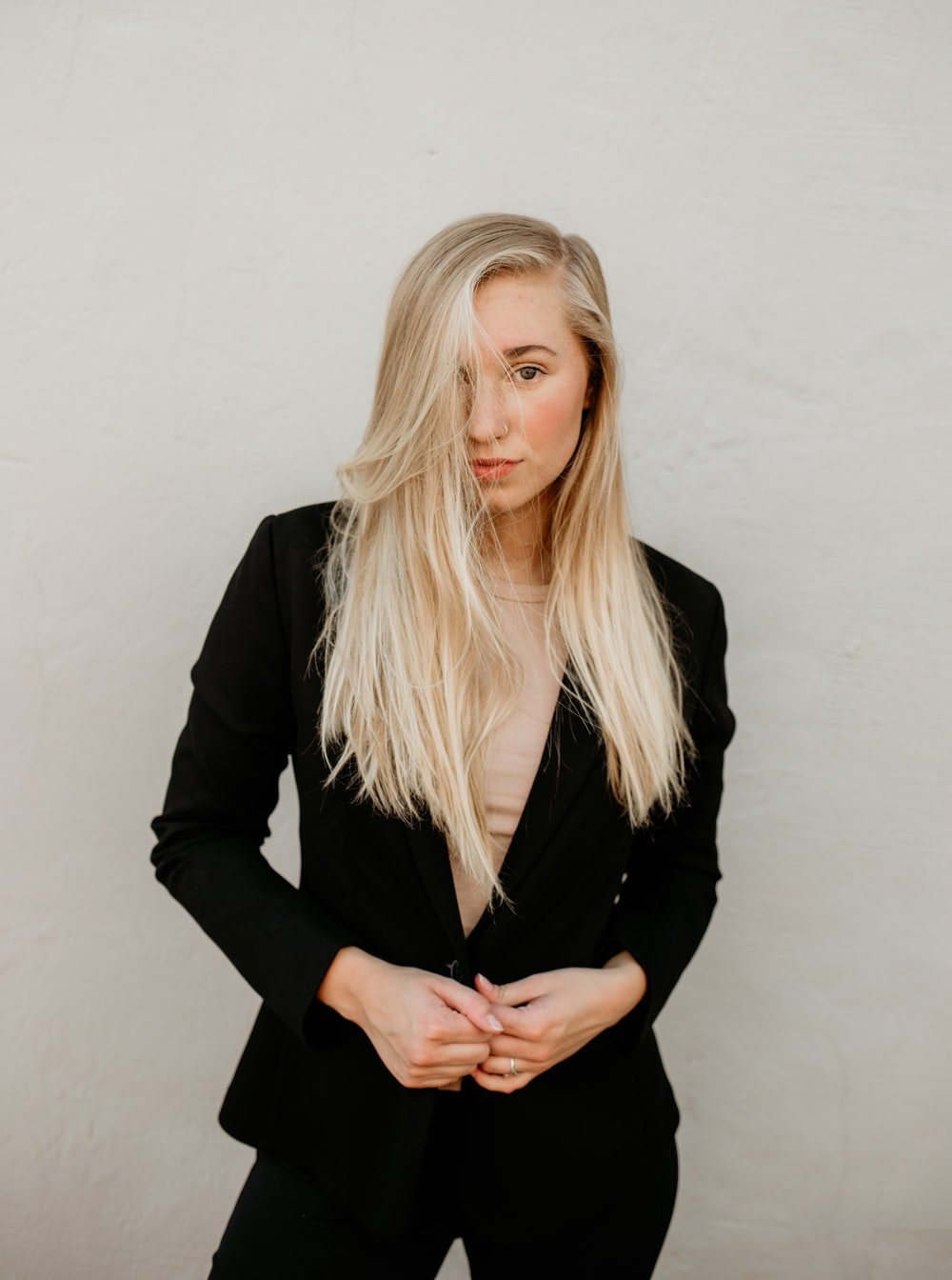 woman wearing black blazer standing