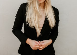 woman wearing black blazer standing