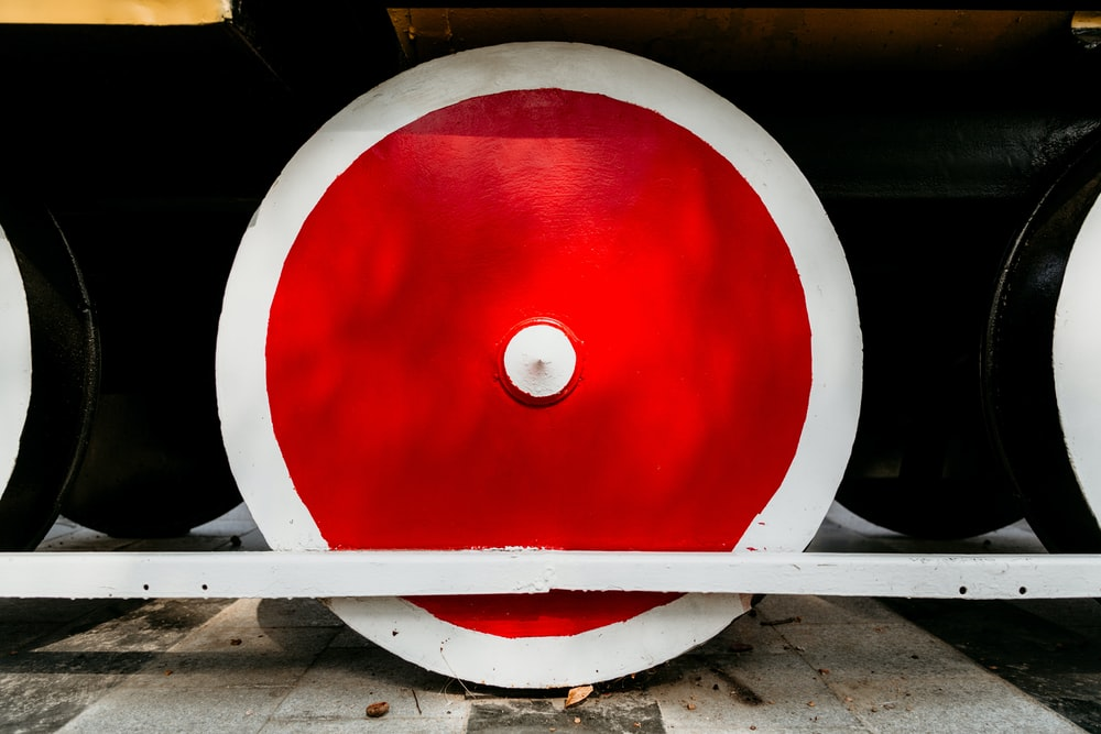 white and red train wheel