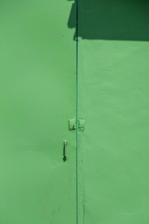 green-painted door