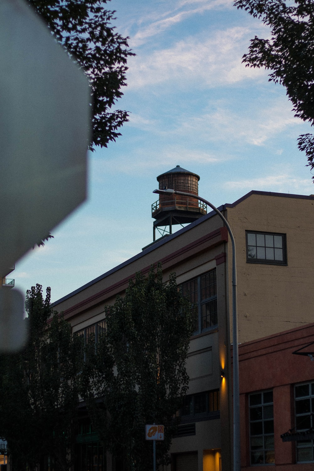 water storage tank on top of building during daytime