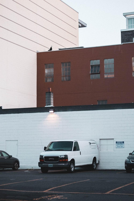 white van beside wall