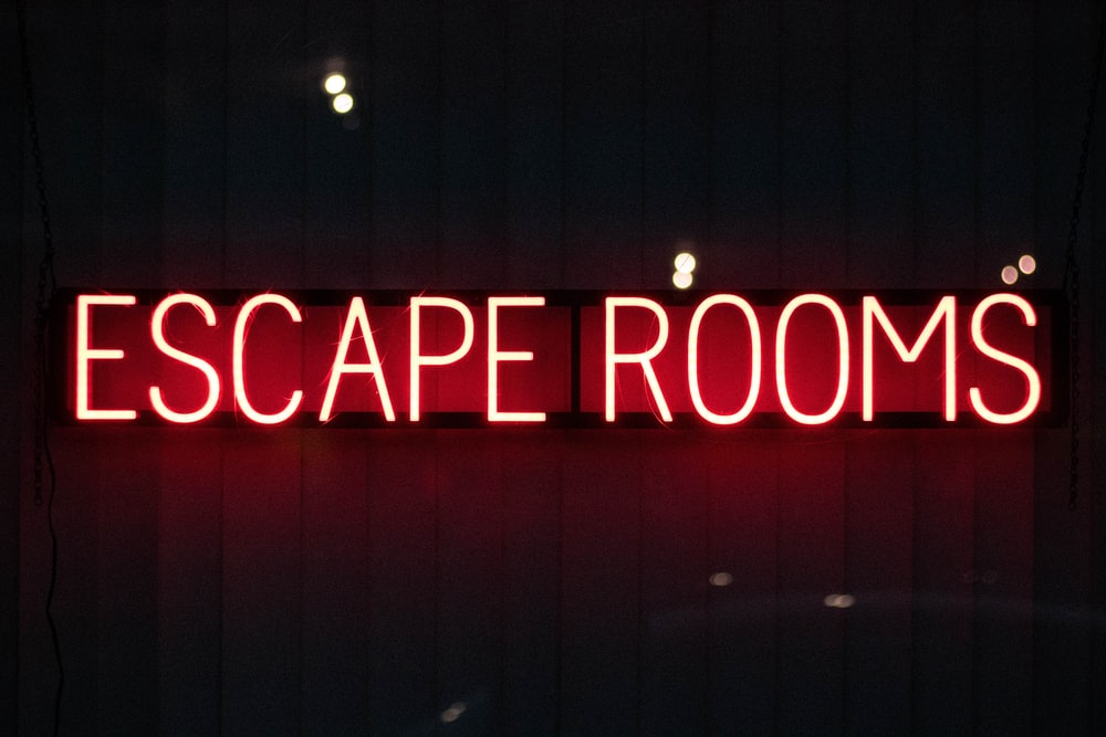 red escape rooms neon sign