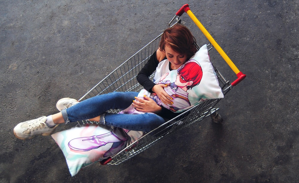 woman inside shopping cart
