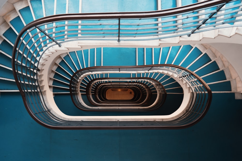 blue and white spiral stairs with no people