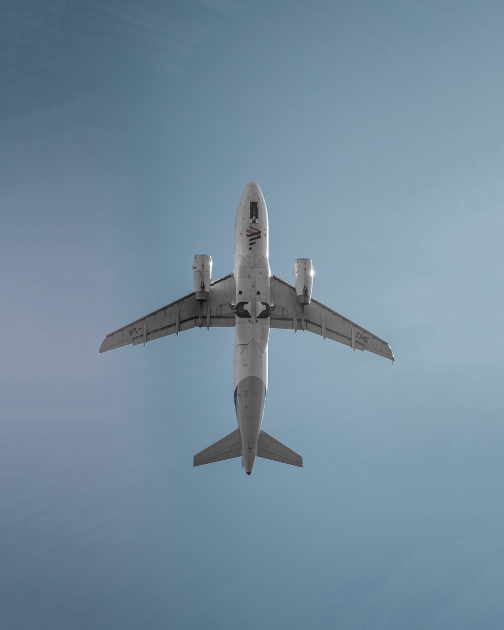 low angle photography of white airplane