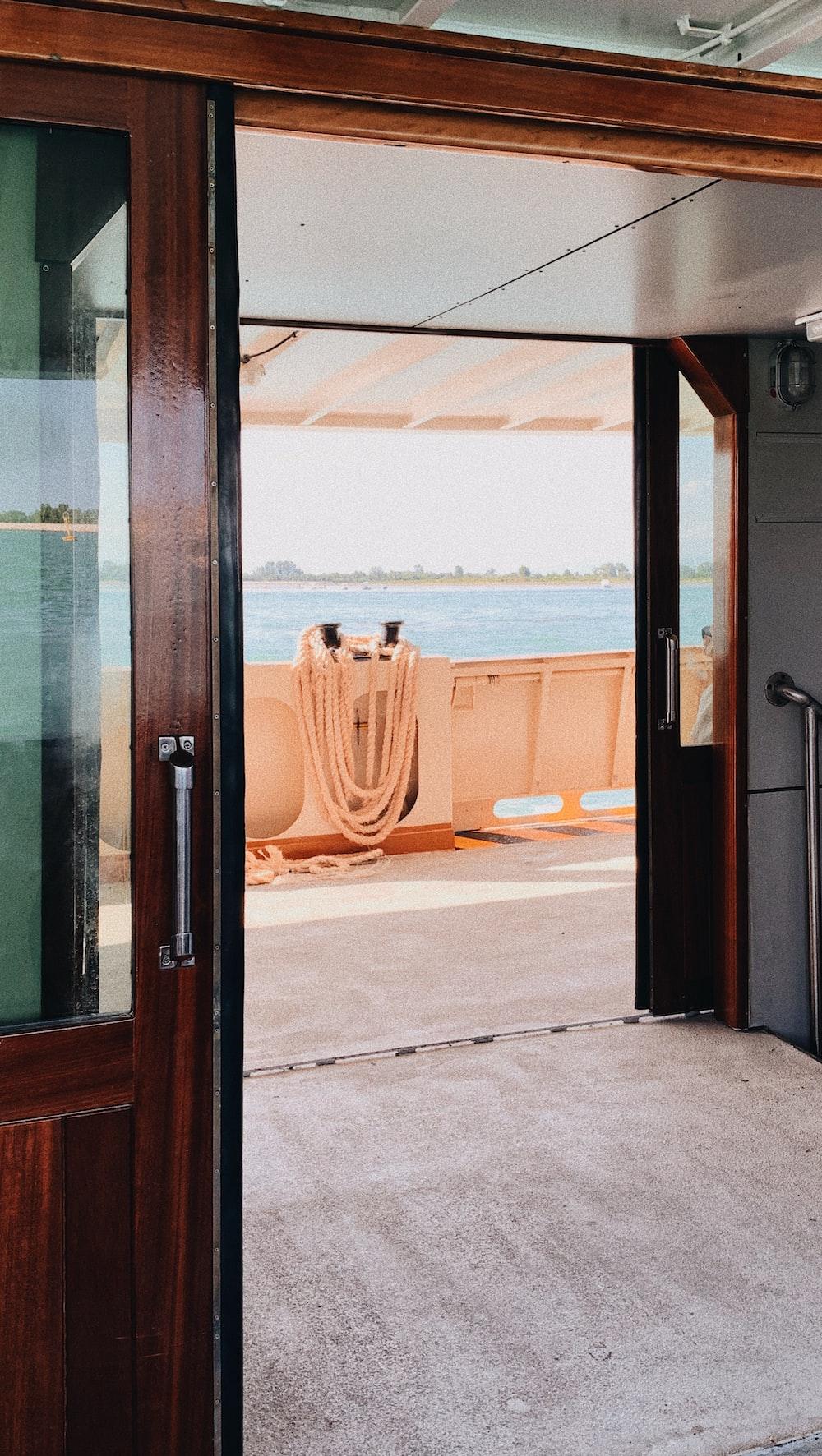 brown wooden cabinet near door