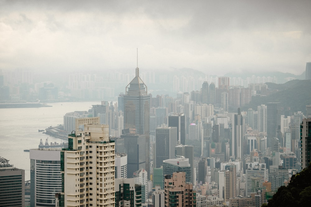 high-angle photography of high-rise buildings under gray sky