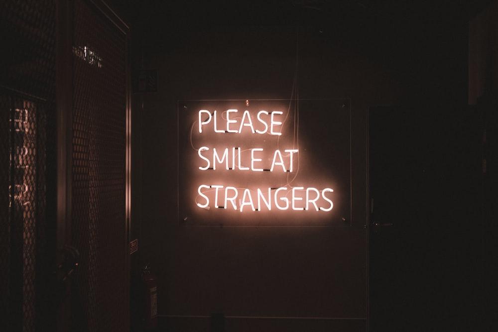 Please Smile at Strangers LED signage
