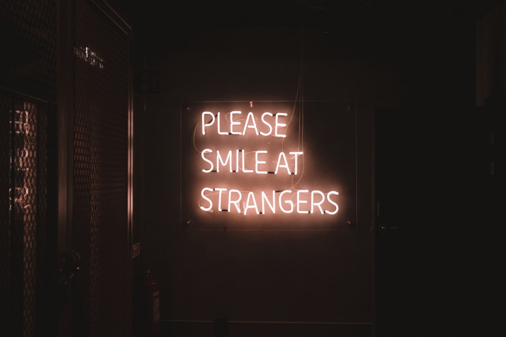 Please Smile at Strangers LED signage