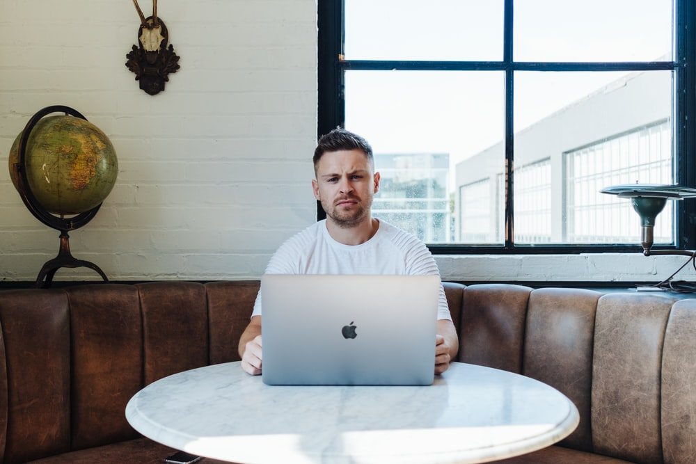 man sitting infront of table
