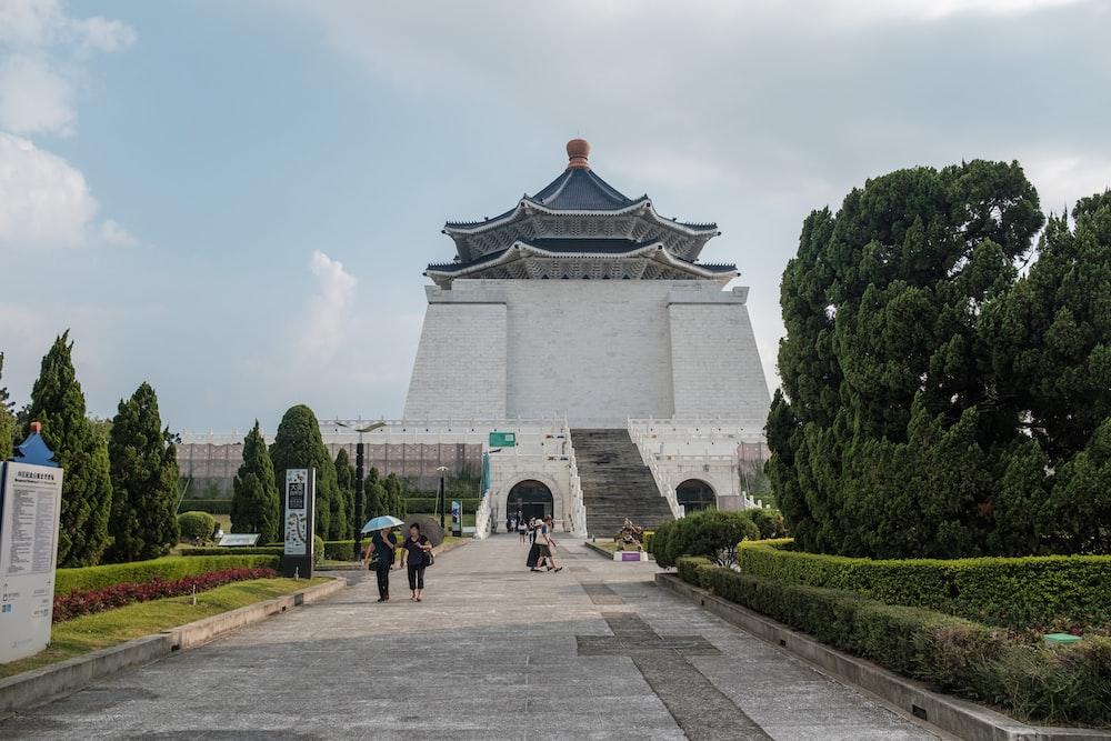 two women walking near cone top building