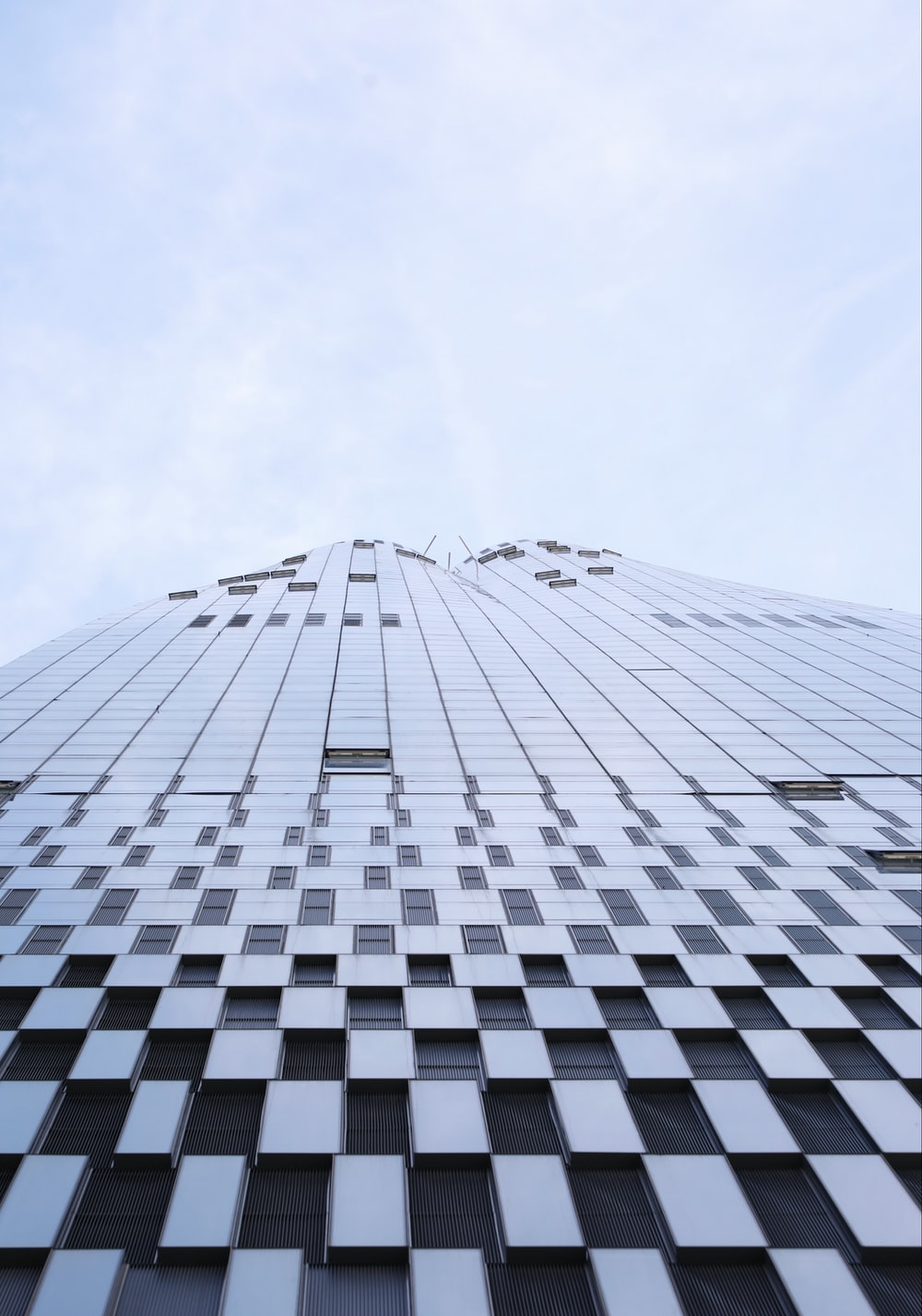 low-angle photography of curtain-wall high-rise building