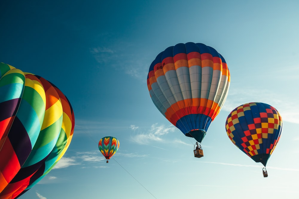 assorted color hot air balloons on sky