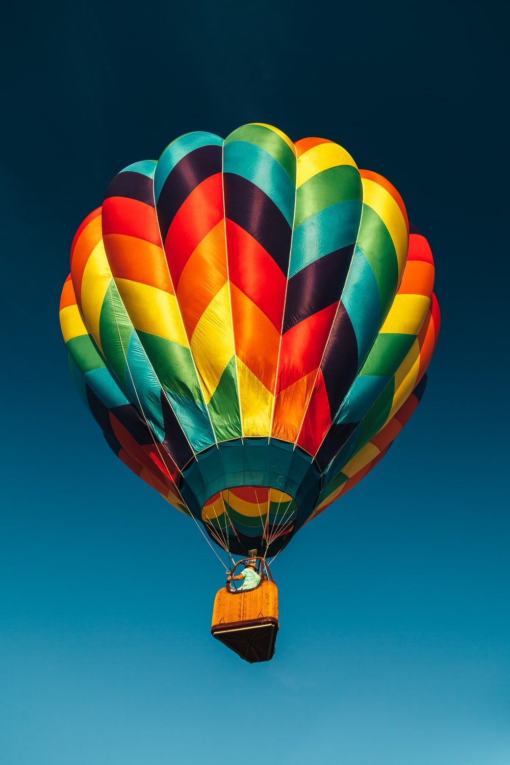 red and multicolored hot air balloon