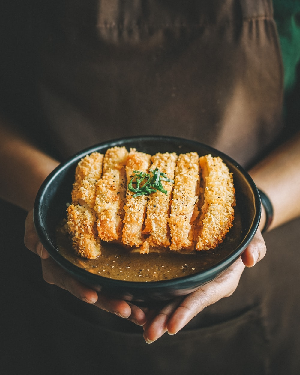 fried dish on round black plate