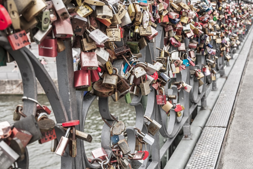 lover's bridge filled with padlock lot