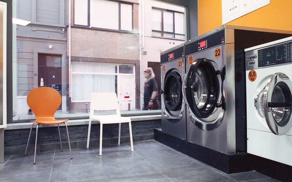 three gray and black front-load washers