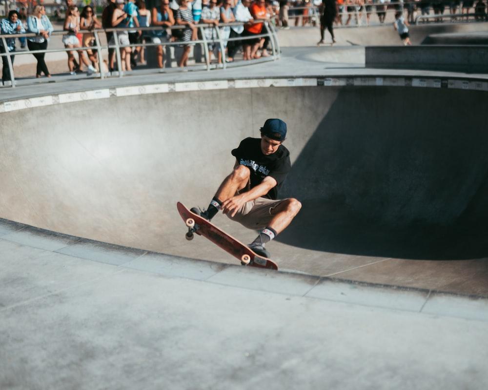man riding on skateboard in skateboard track