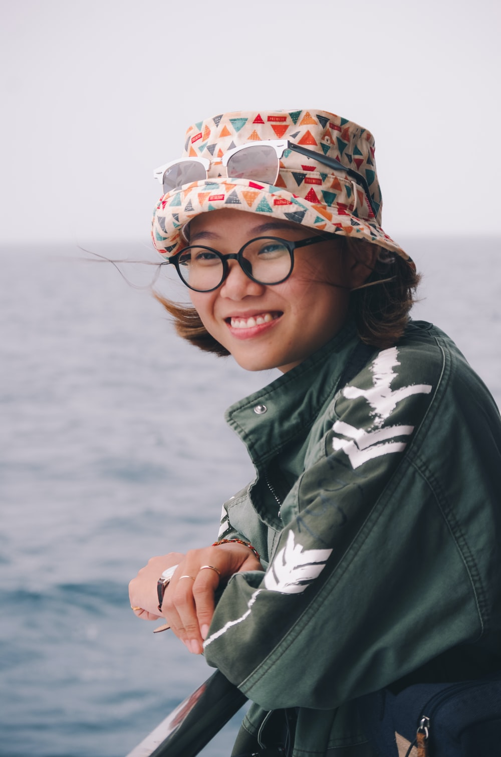 woman wearing green jacket and bucket hat