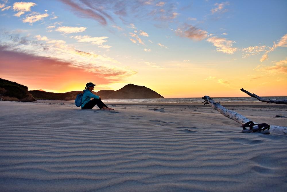 woman sitting on sand