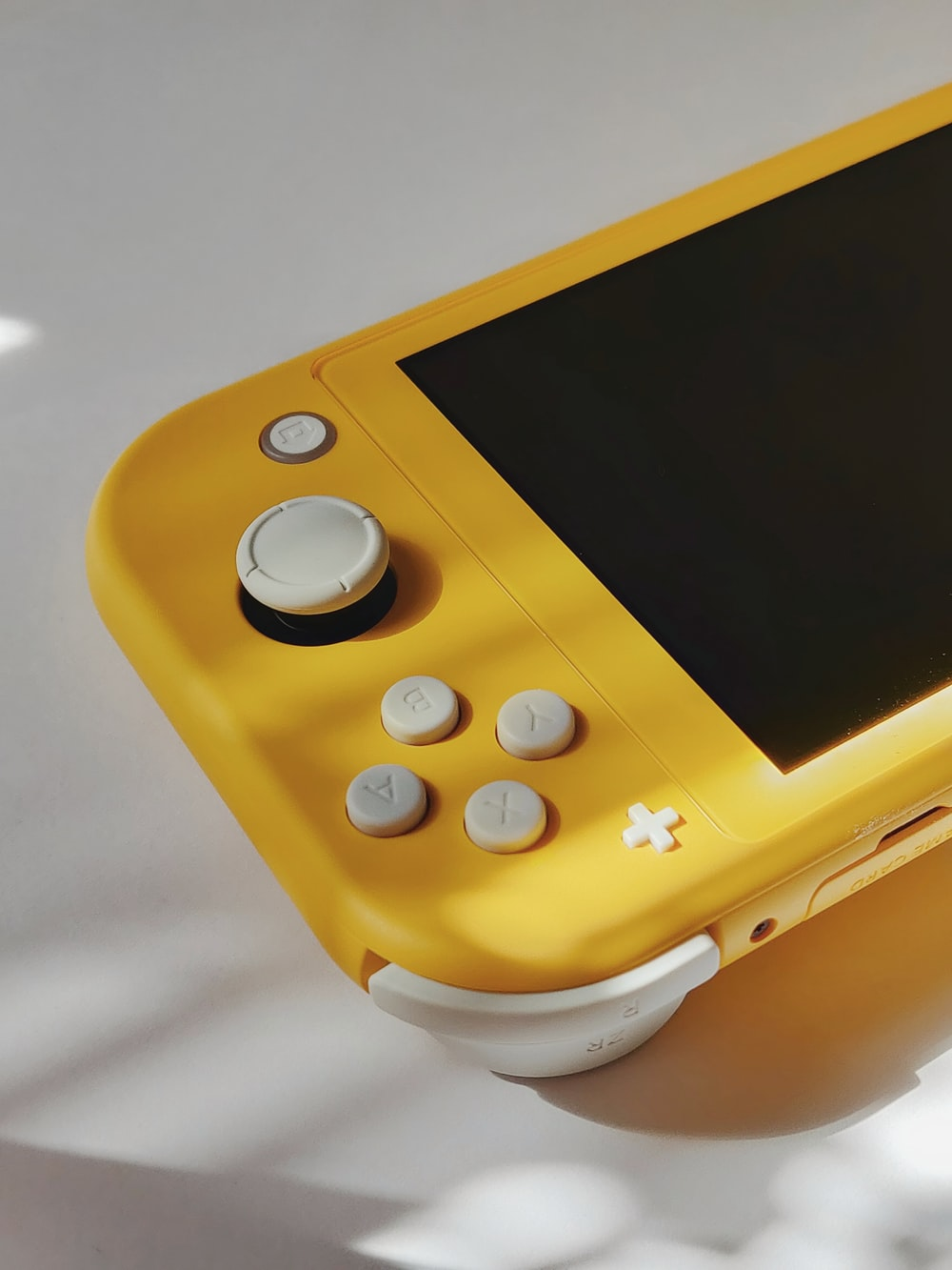 yellow and white game console