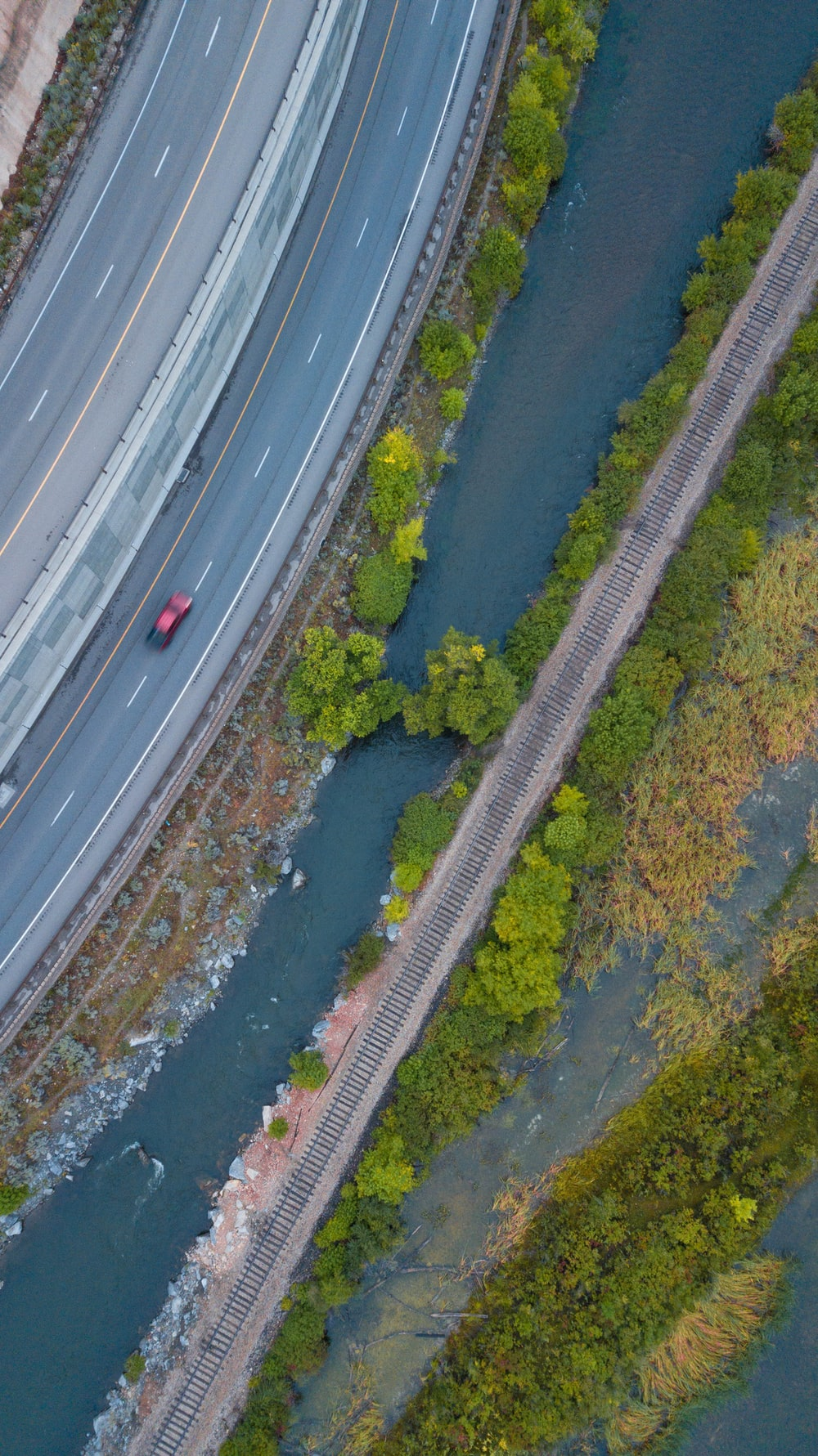 aerial photography of red vehicle on raod