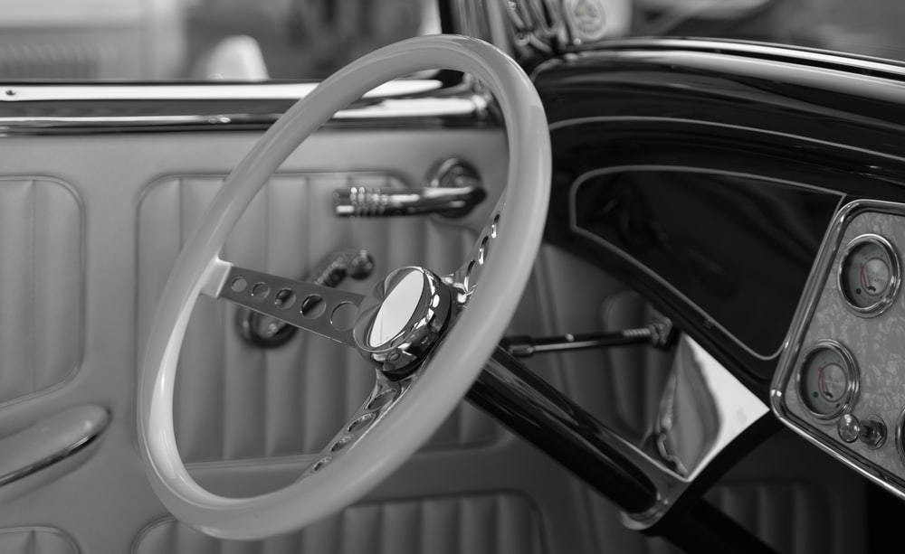 grayscale photography of classic steering wheel