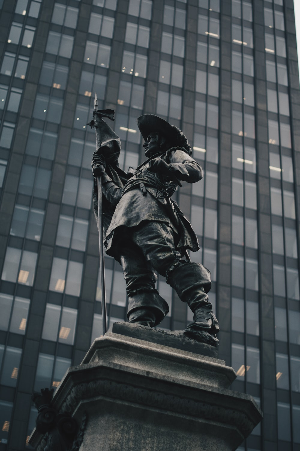 standing man holding spear statue