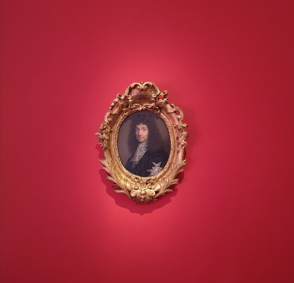portrait painting on man with oval frame wall mouted
