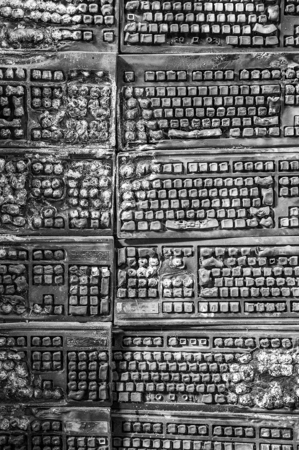 grayscale photo of burnt keyboards