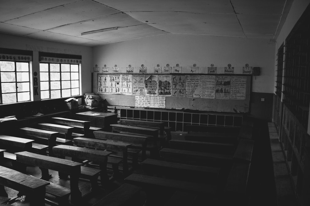 grayscale photo of classroom