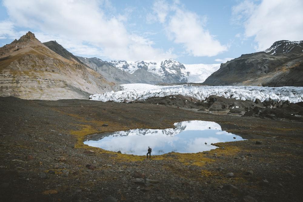 person walking near lake