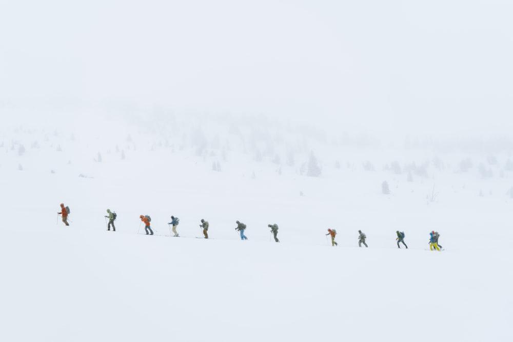 people ice skating on snow grund