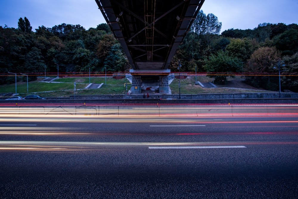lights passing on road under overpass