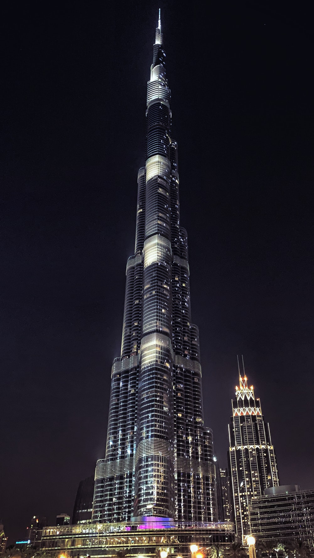 well lighted high rise building at night