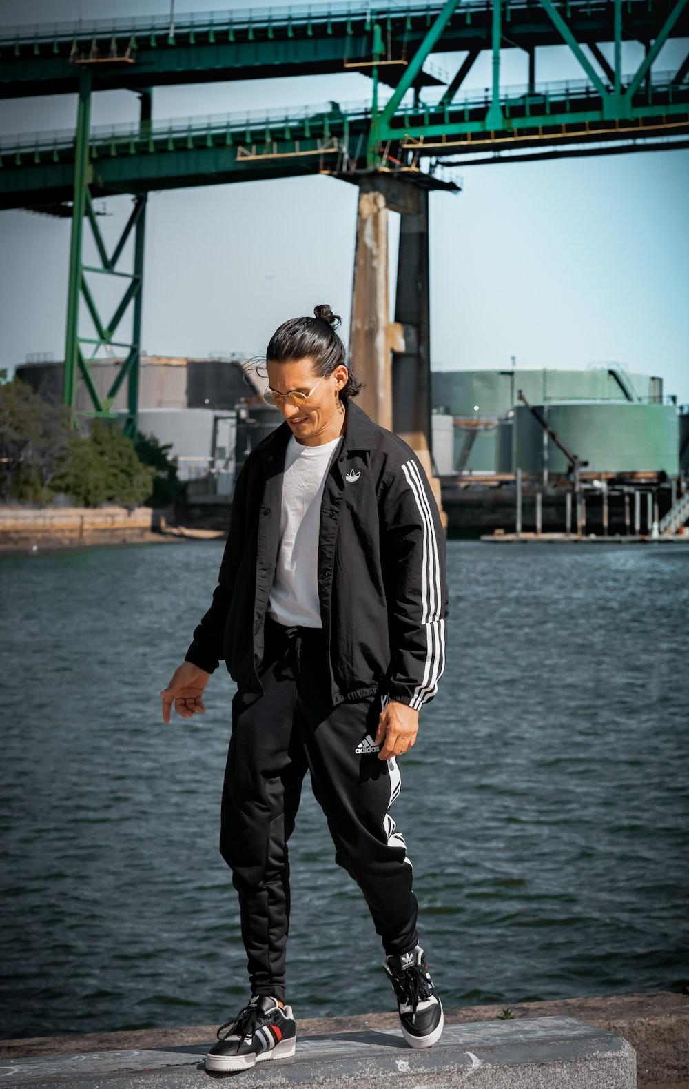 man wearing black and white full-zip jacket