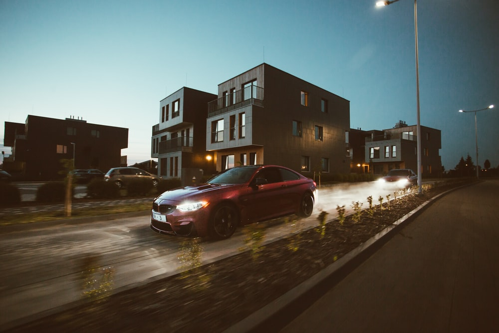 photo of red sedan on street