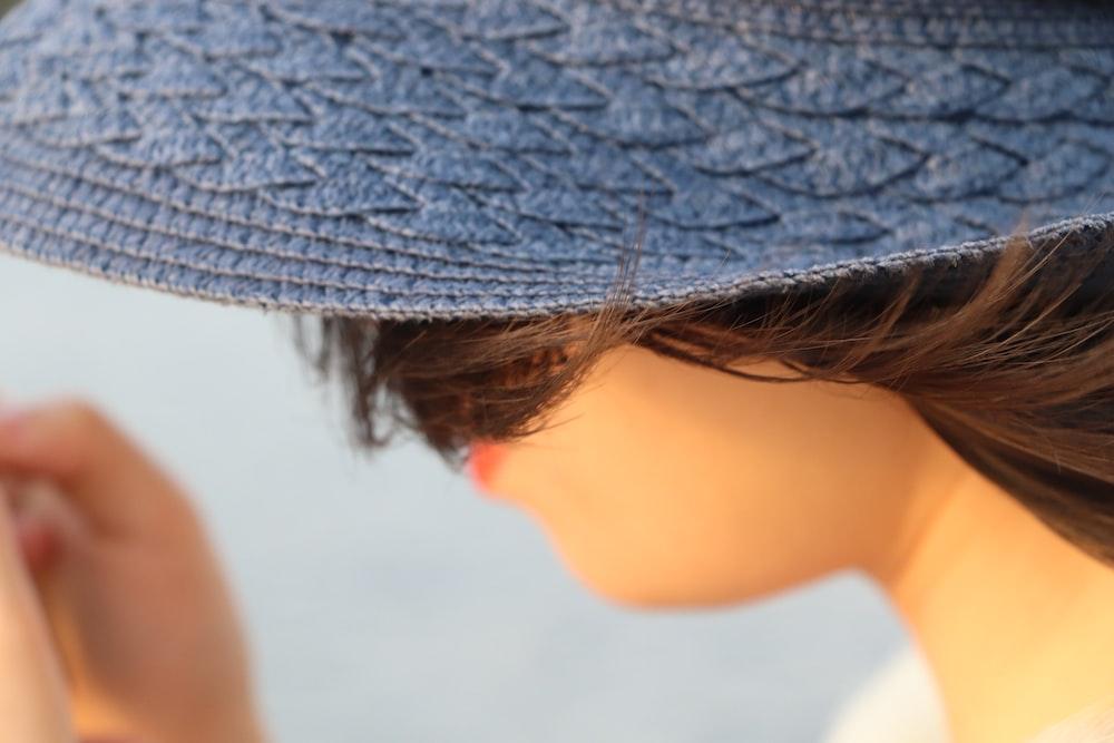 woman wearing gray hat