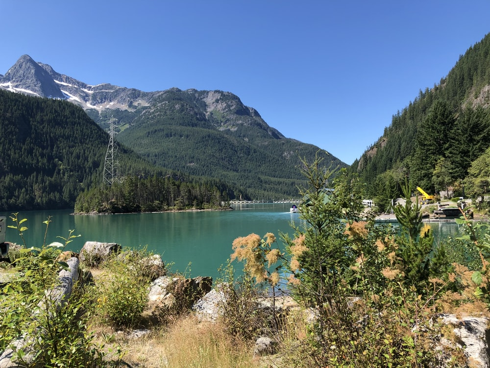 metal tower beside lake