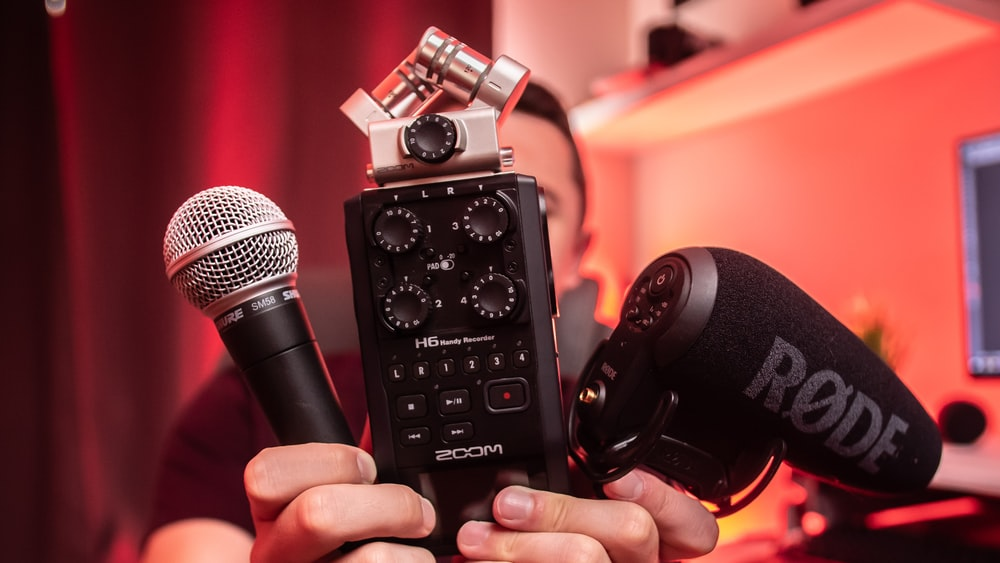 person holding microphones