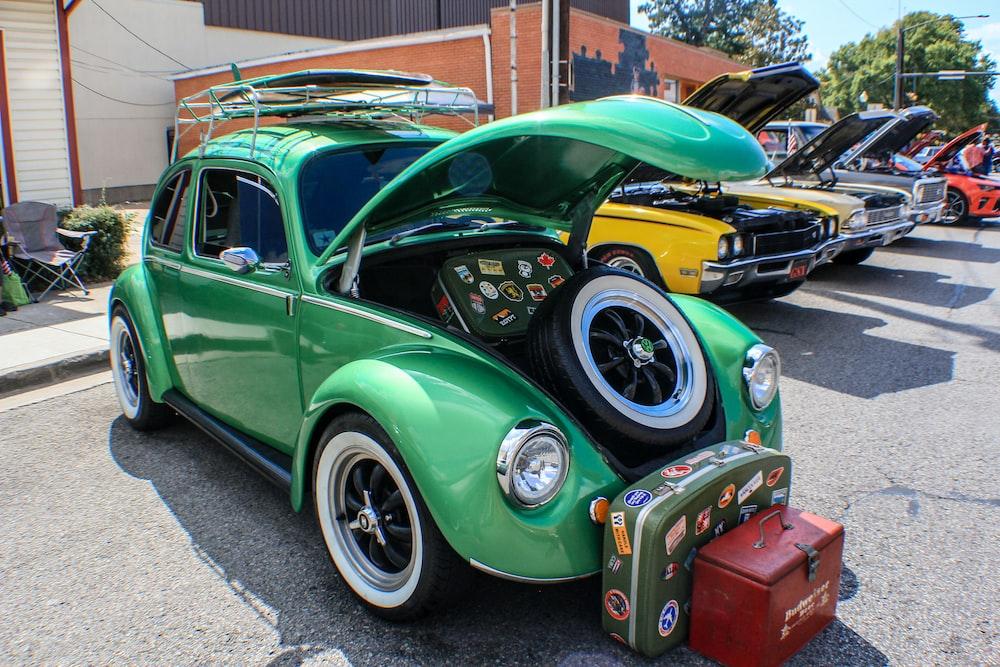 green Volkswagen Beetle during daytime