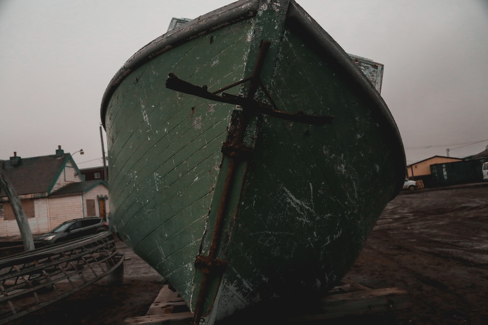 boat on concrete during daytime